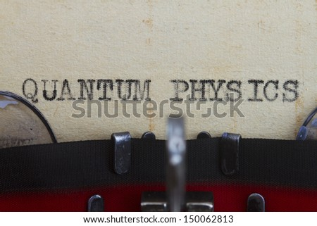 Quantum physics type written in a vintage paper. - stock photo