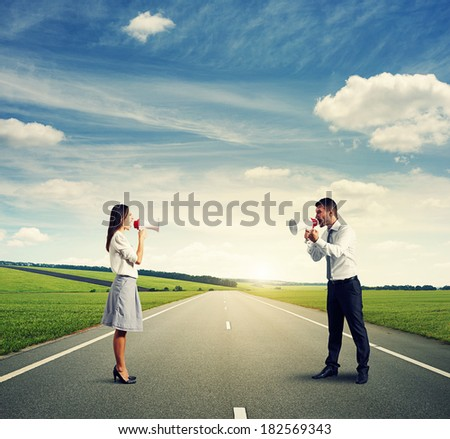 quarrel between angry man and screaming woman on the road - stock photo