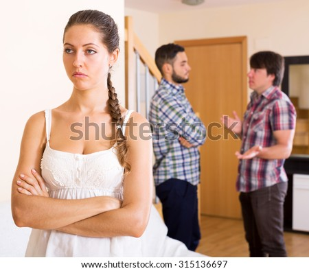 Quarrel in young polygamous family indoors in the living room - stock photo