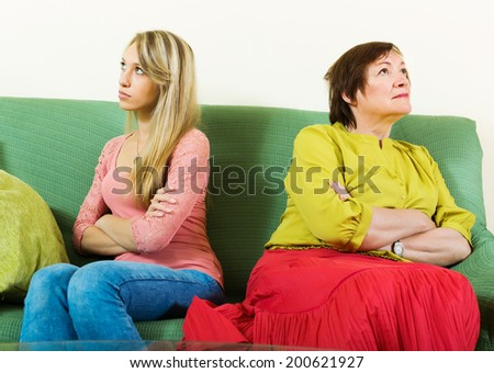 Quarrel of adult daughter and mature mother     at home - stock photo
