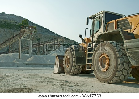 Quarry and Bulldozer. Vertical image - stock photo