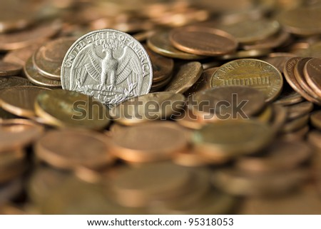 Quarter of a Dollar coin on a pile of pennies representing finance and economy. - stock photo
