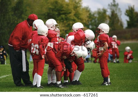 Quarterback calling the play - stock photo