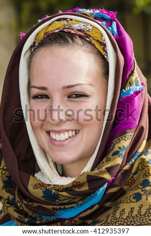 QUARTU S.E., ITALY - September 21, 2014: Parade of Sardinian costumes and floats for the grape festival in honor of the celebration of St. Helena. Portrait of girl in traditional costume of Sardinia - stock photo