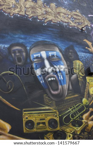 QUEBEC, CANADA-May 5: is year of municipal election in Quebec city. Beautiful graffiti in Quebec city, with young man screaming with quebecian flag maked up in his face on May 5, 2013 in Quebec. - stock photo