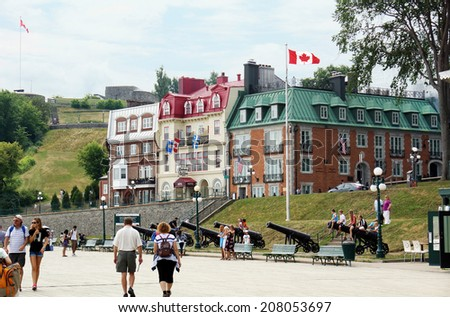 QUEBEC CITY, CANADA - JULY, 20: Tourists on the Terrasse Dufferin in Old Quebec city Canada, on July 20, 2014. Located right above the St. Lawrence this historical area is a UNESCO World Heritage Site - stock photo