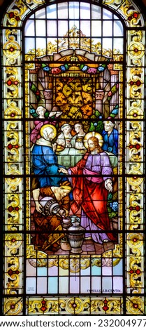 QUEBEC CITY CANADA SEPT 03 2014: Stained glass window Notre Dame des Victoires Church on september 03 2014 in Quebec City Canada. Construction was started in 1687 on site of Champlain's habitation  - stock photo
