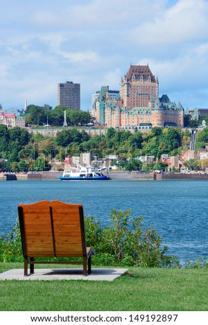 Quebec City skyline over river with blue sky and cloud viewed from park. - stock photo