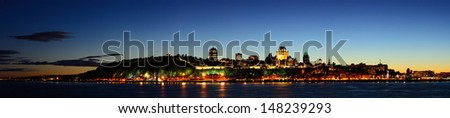 Quebec City skyline panorama at dusk over river viewed from Levis. - stock photo