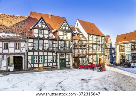 QUEDLINBURG, GERMANY - JAN 8, 2016: scenic old half timbered houses in Quedlinburg, Germany. The town  is known to have existed since at least the early 9th century. - stock photo
