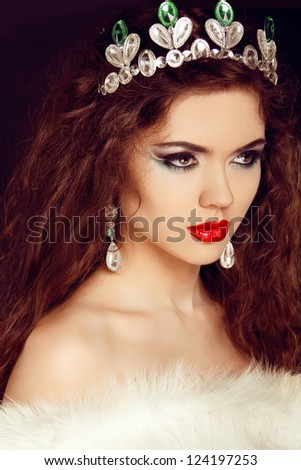 Queen. Beautiful woman in jewelry. Fashion photo - stock photo