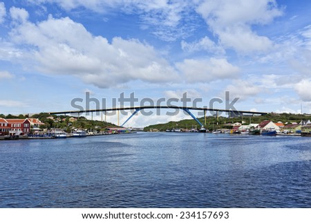 Queen Juliana bridge crossing Saint Anna bay at the harbor of Willemstad, Curacao  - stock photo