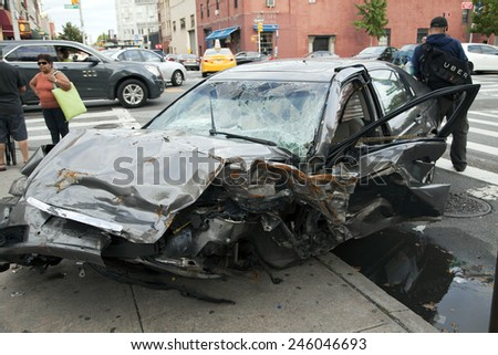 QUEENS, NEW YORK - JULY 2: Car wreck on Vernon Boulevard.   Taken July 2, 2014 in Queens, NY. - stock photo