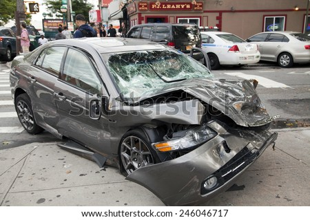 QUEENS, NEW YORK - JULY 2: Car wreck on Vernon Boulevard   Taken July 2, 2014 in Queens, NY. - stock photo