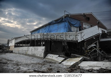 QUEENS, NY - NOVEMBER 11: Damaged houses without power at night in the Rockaway beach - Bel Harbor area due to impact from Hurricane Sandy in Queens, New York, U.S., on November 11, 2012. - stock photo
