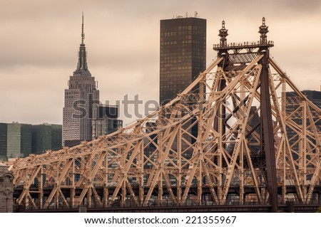 Queensboro Bridge and Empire State Buliding with Manhattan view - stock photo