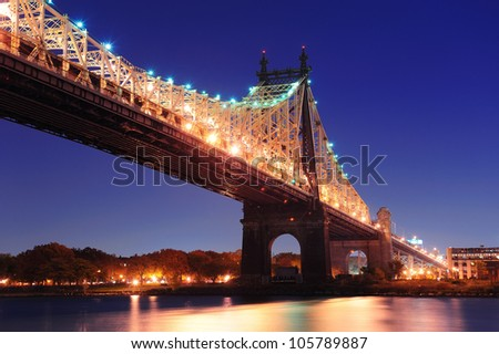 Queensboro Bridge over New York City East River at dusk viewed from midtown Manhattan. - stock photo