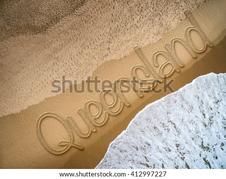 Queensland written on the beach - stock photo