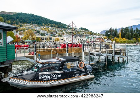 Queenstown,New Zealand - April 30,2016 : Boats parking at the jetty of Lake Wakatipu in Queenstown, New Zealand. - stock photo