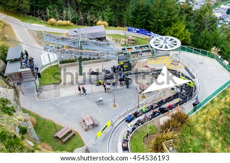 Queenstown,New Zealand - April 25,2016 : People can seen playing luge car in Queenstown Skyline,New Zealand. - stock photo