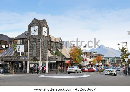 Queenstown, New Zealand - April 10, 2011: Queenstown is quiet and beautiful city surrounded by mountain. Even at the clock tower, city center of Queenstown, there is only light traffic. - stock photo