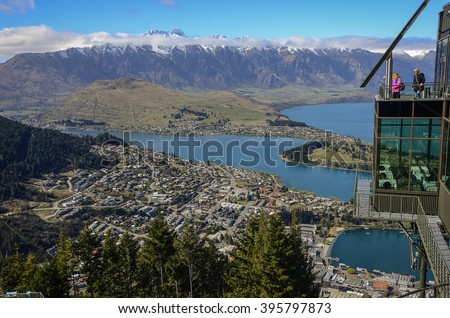 QUEENSTOWN, NEW ZEALAND - AUG. 24: The winter view of the popular ski resort of Queenstown, seen from Bob's Peak viewing platform on August 24, 2014 in Queenstown, New Zealand.  - stock photo
