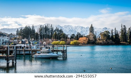 QUEENSTOWN, NEW ZEALAND - AUGUST 24: Lake Wakatipu and The Remarkables in Winter - 24 August, 2013. Queenstown is the Southern Hemisphere's premier four season lake and alpine resort. - stock photo