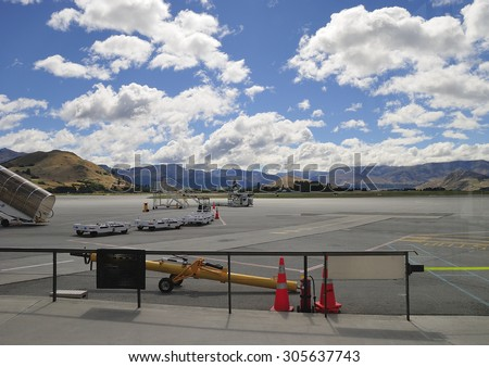 QUEENSTOWN, NEW ZEALAND - June 30, 2015: Queenstown Airport is New Zealandâ??s fourth busiest airport for passenger numbers, hosting 1.25 million passengers in the 2013-2014 financial year. - stock photo