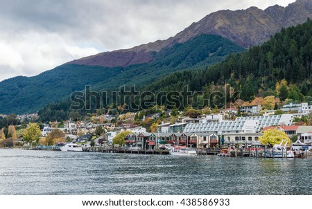 QUEENSTOWN, NEW ZEALAND-MAY 10, 2016 : A beautiful scenery of cityscape of Queenstown, New zealand from the other side of the lake - stock photo