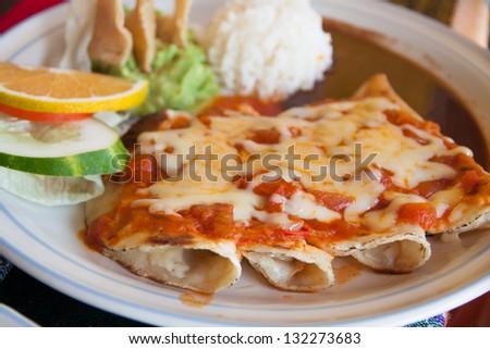 Quesadillas with guacamole and tomato sauce - stock photo