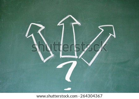 question mark and three arrows sign on blackboard - stock photo