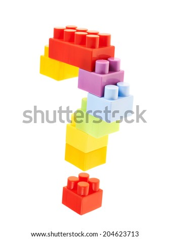 Question mark made of colorful plastic toy construction bricks, isolated over the white background - stock photo