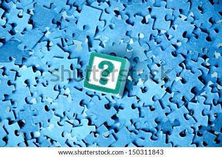 Question  mark on a puzzle  background  - stock photo