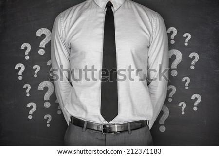 Question Mark on Blackboard - stock photo