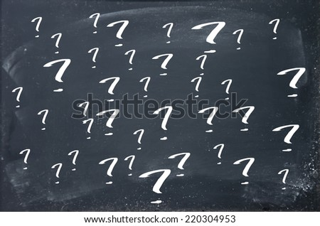 question mark on blackboard - stock photo