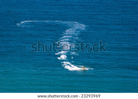 Question mark on water drawn by a jetski - stock photo