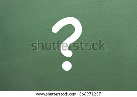 question mark written on a chalkboard - stock photo