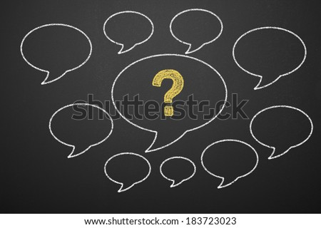 Question marks on the blackboard - stock photo