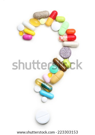 Question sign from pills, various pharmaceuticals isolated on white background. - stock photo