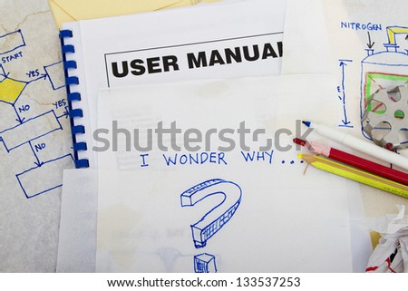 Question sketch with engineering sketches and user manual book. - stock photo