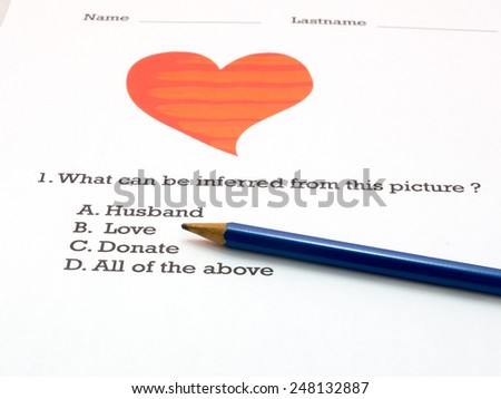 Questionnaire about picture heart and relate word,  filling out answers to a test with a blue pencil. Is this call Love. (Close-up answer) - stock photo