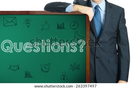 Questions on blackboard presenting by businessman or teacher - stock photo