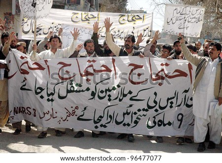 QUETTA, PAKISTAN - MAR 01: NARS-B Project employees chant slogans in favor of their demands during a protest demonstration at Quetta press club on Thursday, March 01, 2012 in Quetta. - stock photo