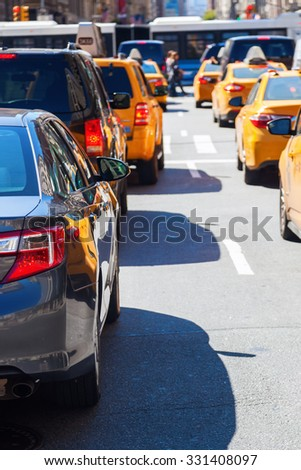 queue of cars and yellow cabs in New York City  - stock photo