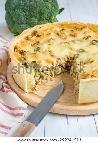 Quiche lorraine with chicken, mushrooms and broccoli - stock photo