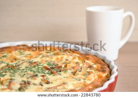 quiche on a plate, very shallow DOF - stock photo
