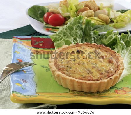 Quiche with a side salad. - stock photo