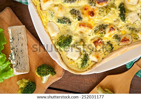 Quiche with broccoli and feta cheese - stock photo