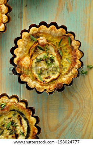 Quiche with grilled zucchini smoked cheese and herbs - stock photo