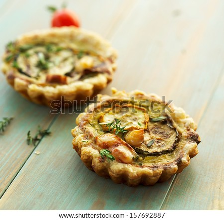 Quiche with grilled zucchini, smoked cheese and thyme - stock photo